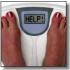 """Immagine di bilancia con piedi femminili sopra che si pesano e al posto del peso compare la scritta """"HELP!"""""""